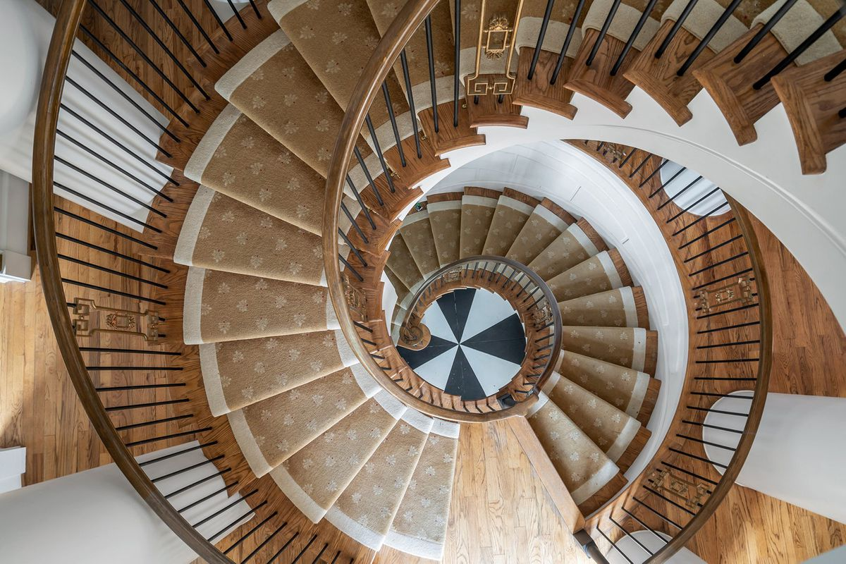 A huge spiral staircase with a checkerboard finish at bottom.
