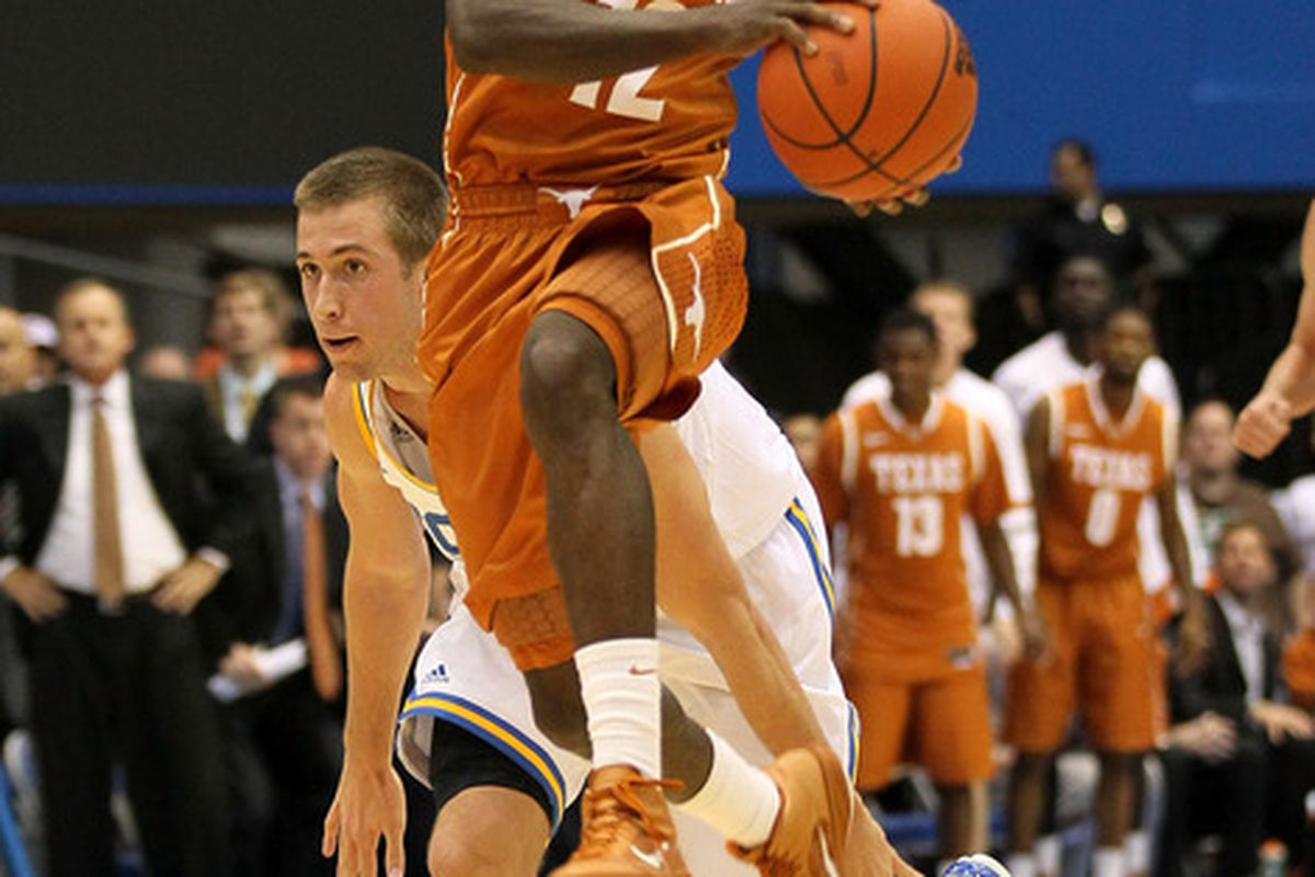 Myck Kabongo of the Texas Longhorns jumps to pass the ball in front of David Wear  at LA Sports Arena on December 3, 2011.