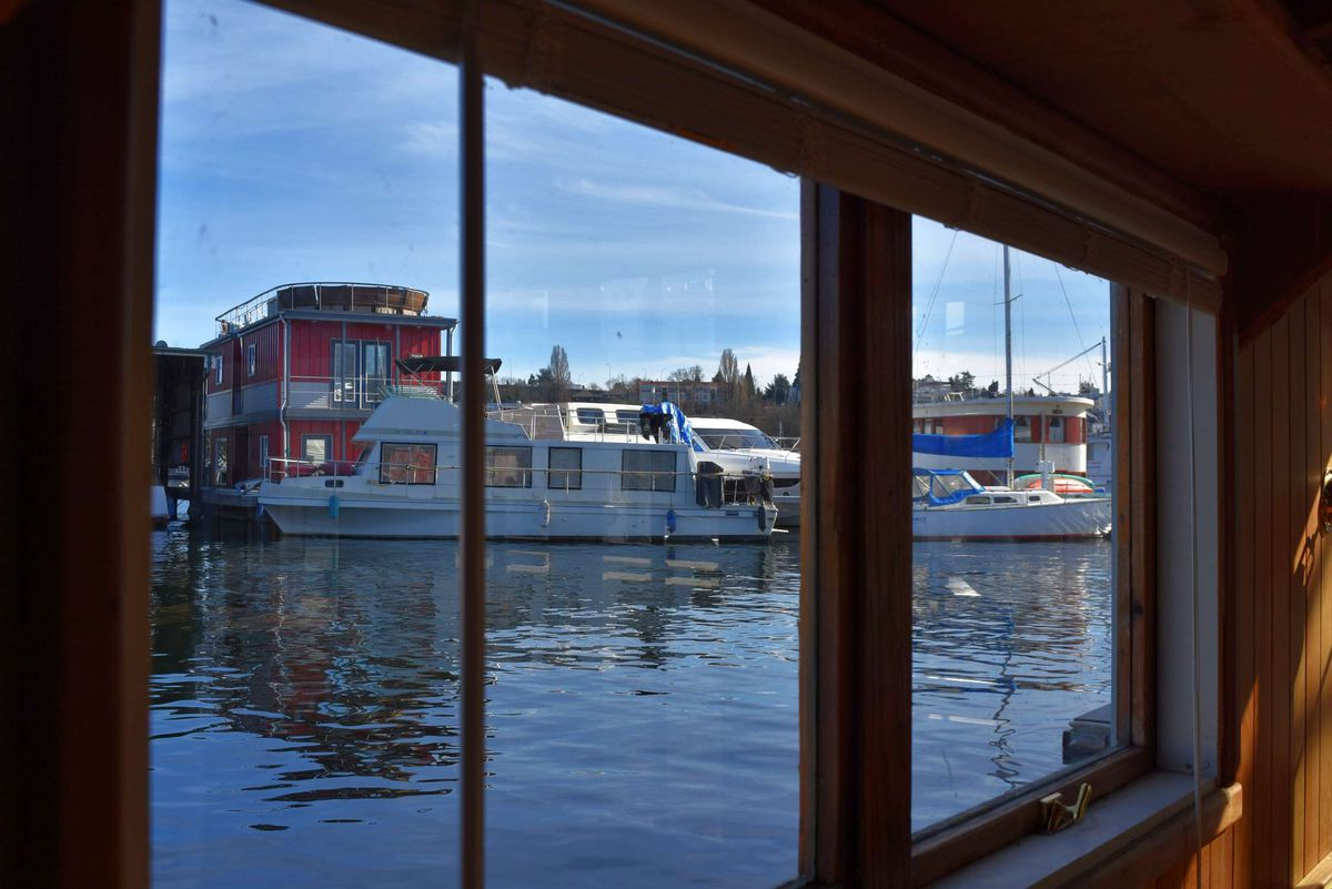 A houseboat window looks out on Lake Union