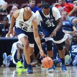 Rod Sellers and Rashad Anderson battle for a loose ball.