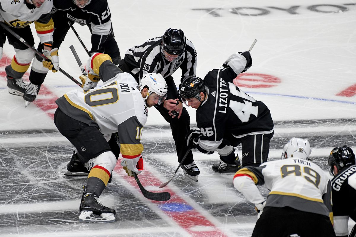 Los Angeles Kings Center Blake Lizotte (46) and Vegas Golden Knights Center Nicolas Roy (10) await the drop of the puck during an NHL game between the Las Vegas Golden Knights and the Los Angeles Kings on April 12, 2021, at the Staples Center in Los Angeles, CA.