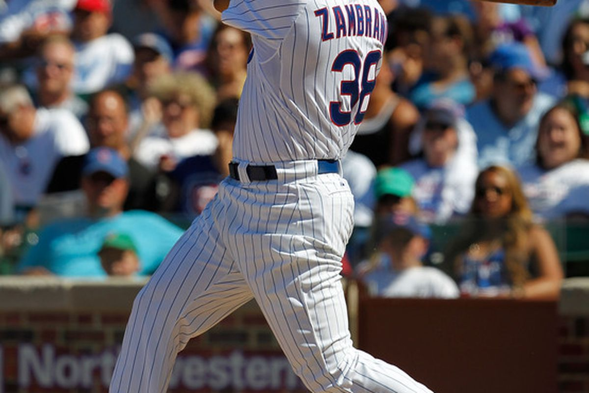 Carlos Zambrano of the Chicago Cubs hits against the Los Angeles Angels of Anaheim at Wrigley Field in Chicago, Illinois. The Cubs defeated the Angels 12-1. (Photo by Jonathan Daniel/Getty Images)