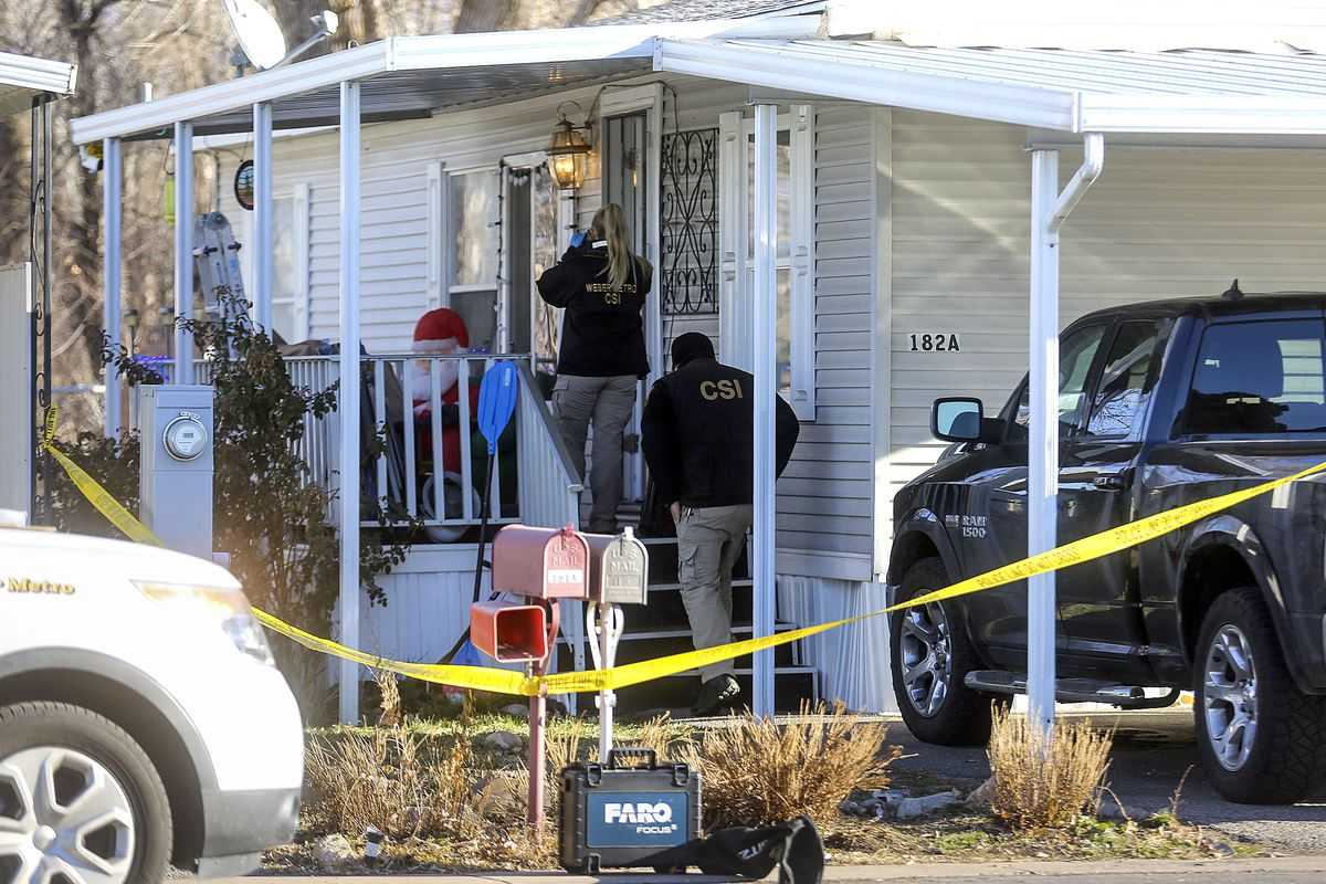 Weber Metro CSI unit members work at the scene of a fatal shooting that occurred early Christmas morning in Riverdale, Weber County, on Friday, Dec. 25, 2020.
