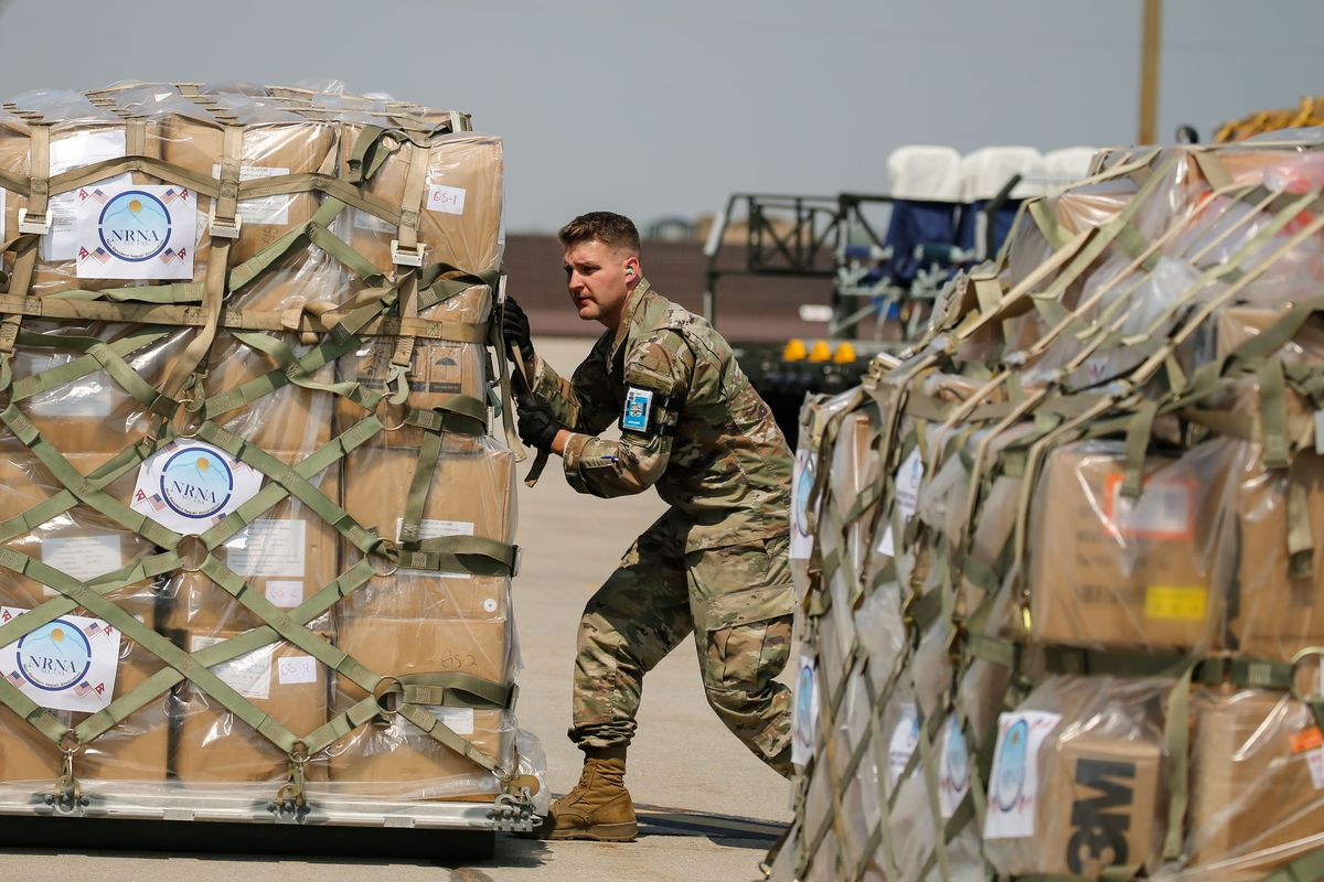 A member of the Utah Air National Guard's 151st Air Refueling Wing loads equipment and supplies to assist Nepal's COVID-19 response on a KC-135 at Roland R. Wright Air National Guard Base in Salt Lake City on Thursday, Aug. 26, 2021.