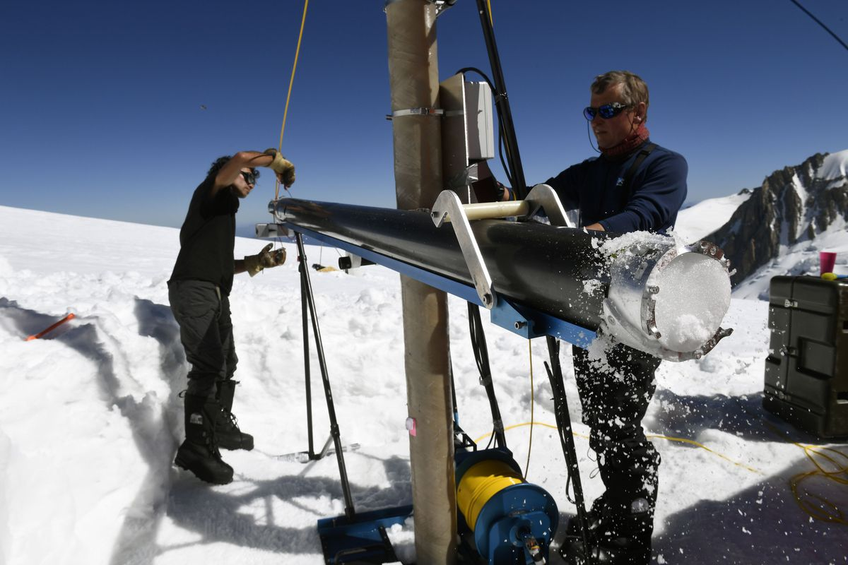 "Members of the ""Ice Memory project"" extract an ice core piece out of a drill machine, on August 25, 2016."