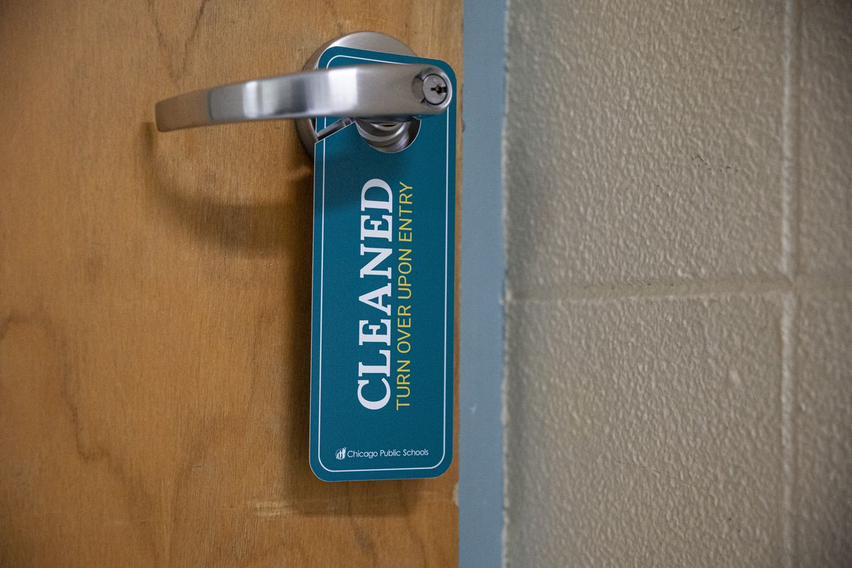 A door hanger signals a cleaned room at South Shore Fine Arts Academy at 1415 E 70th St. in South Shore on Wednesday, Jan. 6, 2021.