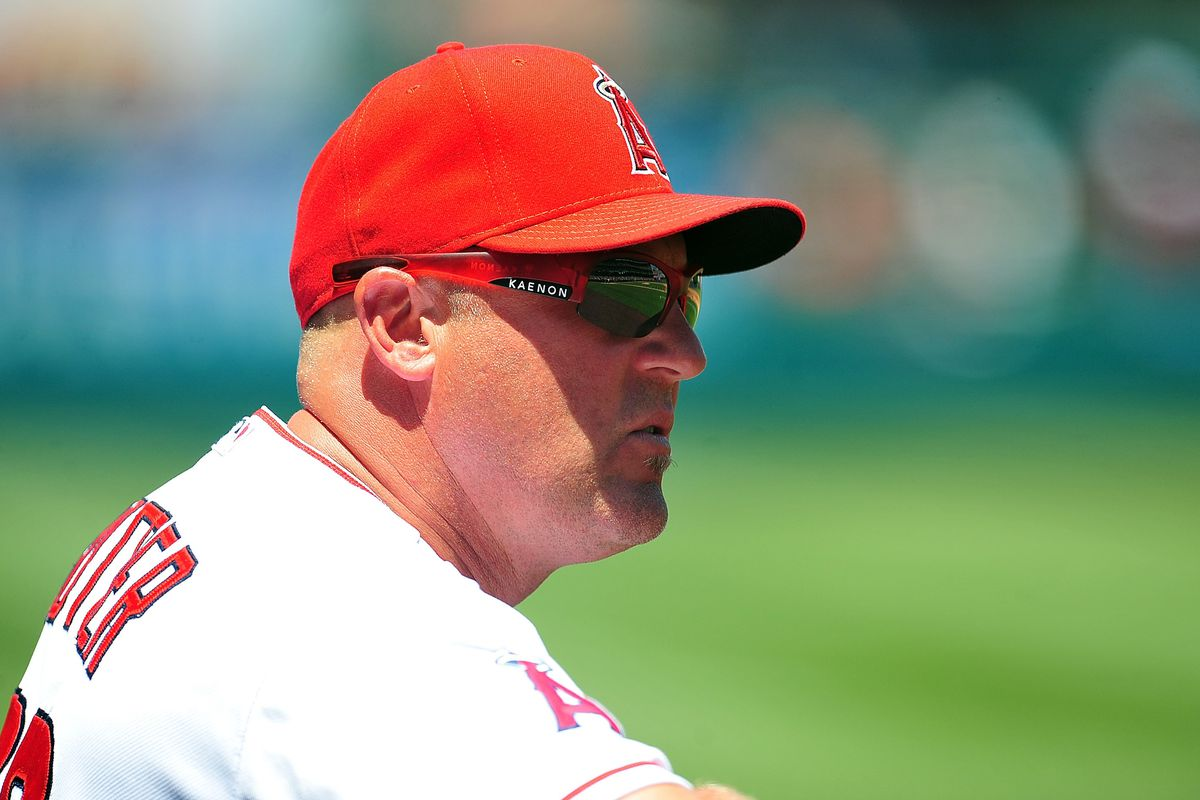 July 25, 2012; Anaheim, CA, USA; Los Angeles Angels pitching coach Mike Butcher (23) watches game action during the second inning against the Kansas City Royals at Angel Stadium. Mandatory Credit: Gary A. Vasquez-US PRESSWIRE