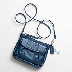 "Coach Spring '11: <a href=""http://www.coach.com/online/handbags/-handbags_silhouettes_crossbody-10551-10051-5000000000000015030-en?t1Id=62&t2Id=5000000000000015030&tier=2&LOC=CC"" rel=""nofollow"">Poppy</a> Leather Pocket Bag in Silver/Cobalt, $1"