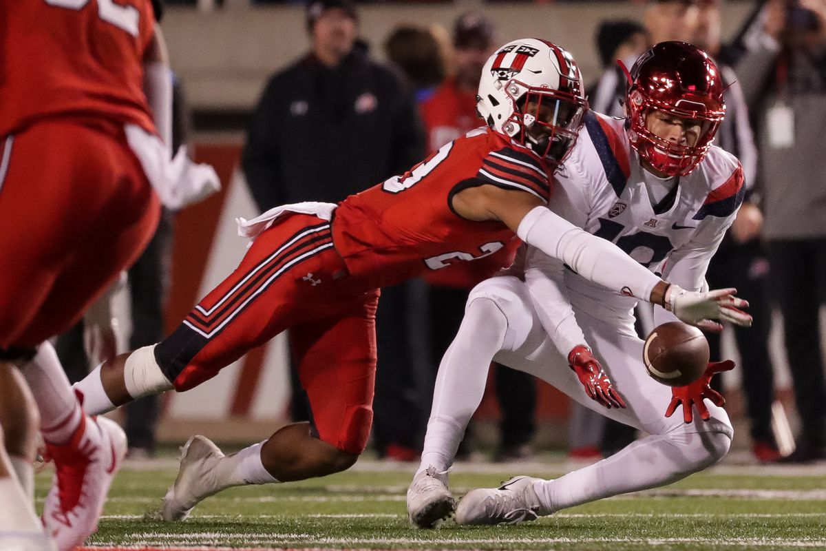 Utah Utes defensive back Julian Blackmon (23) breaks up a pass intended for Arizona Wildcats safety Scottie Young Jr. (19) during the game at Rice-Eccles Stadium in Salt Lake City on Friday, Oct. 12, 2018.