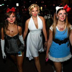 Three women make their way to the evening festivities at Dragon Con in Atlanta, on Friday, Aug. 31, 2012. The annual science fiction and fantasy convention drew big crowds and had more than 30,000 pre-registered attendees.