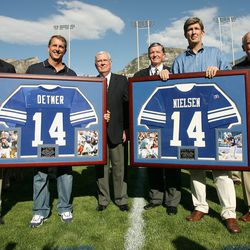 Former BYU players Gifford Nielsen and Ty Detmer - along with BYU athletic director Tom Holmoe, Elder M. Russell Ballard, BYU President Cecil Samuelson and BYU head football coach LaVell Edwards - watch the retirement of their jerseys in Provo on Sept. 1, 2007.