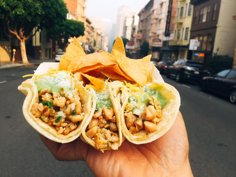 Three tacos and a side of nachos