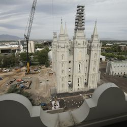Crews remove the capstone after the Angel Moroni statue is removed from atop the Salt Lake Temple of The Church of Jesus Christ of Latter-day Saints during renovation in Salt Lake City on Monday, May 18, 2020.