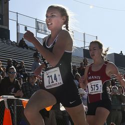 North Sanpete High School's Aubrey Cook (714) outsprints Manti High School's Fiel Woods at the finish line for second place during the 3A Girls State Cross-Country Championships at Highland High School in Salt Lake City on Wednesday, Oct. 23, 2019.