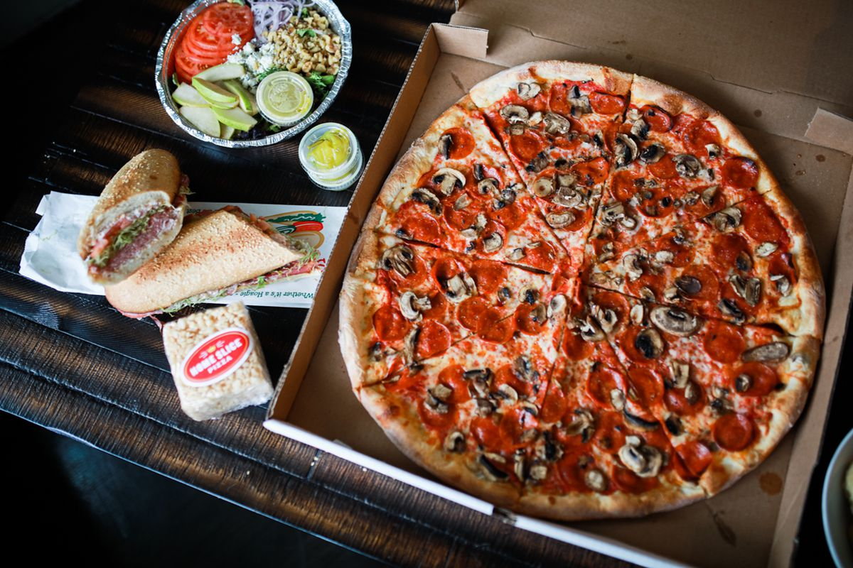 To-go pizza at Home Slice