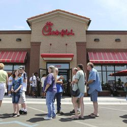 FILE - In a Wednesday. Aug. 1, 2012 file photo, customers stand in line for a Chick-fil-a meal at the chain's restaurant in Wichita, Kan. The crowd was buying meals to show their support for the company that's currently embroiled in a controversy over same-sex marriage. On this and so many other issues this election year, it seems harder to find that middle-ground gray when our debates seem so very black or white.