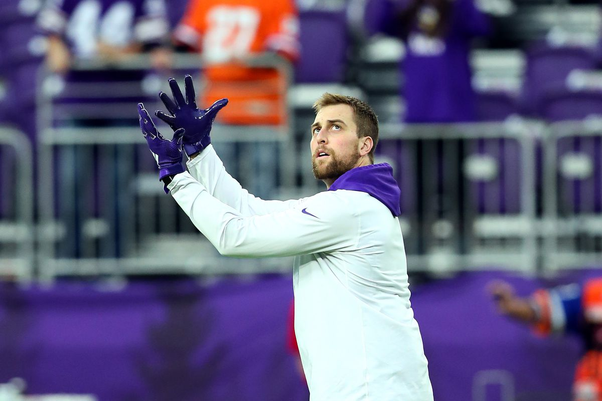 Adam Thielen of the Minnesota Vikings catches a football before a game against the Denver Broncos at U.S. Bank Stadium on November 17, 2019 in Minneapolis, Minnesota.