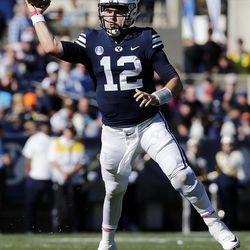 Brigham Young Cougars quarterback Tanner Mangum passes the ball against the San Jose State Spartans during NCAA football in Provo on Saturday, Oct. 28, 2017.