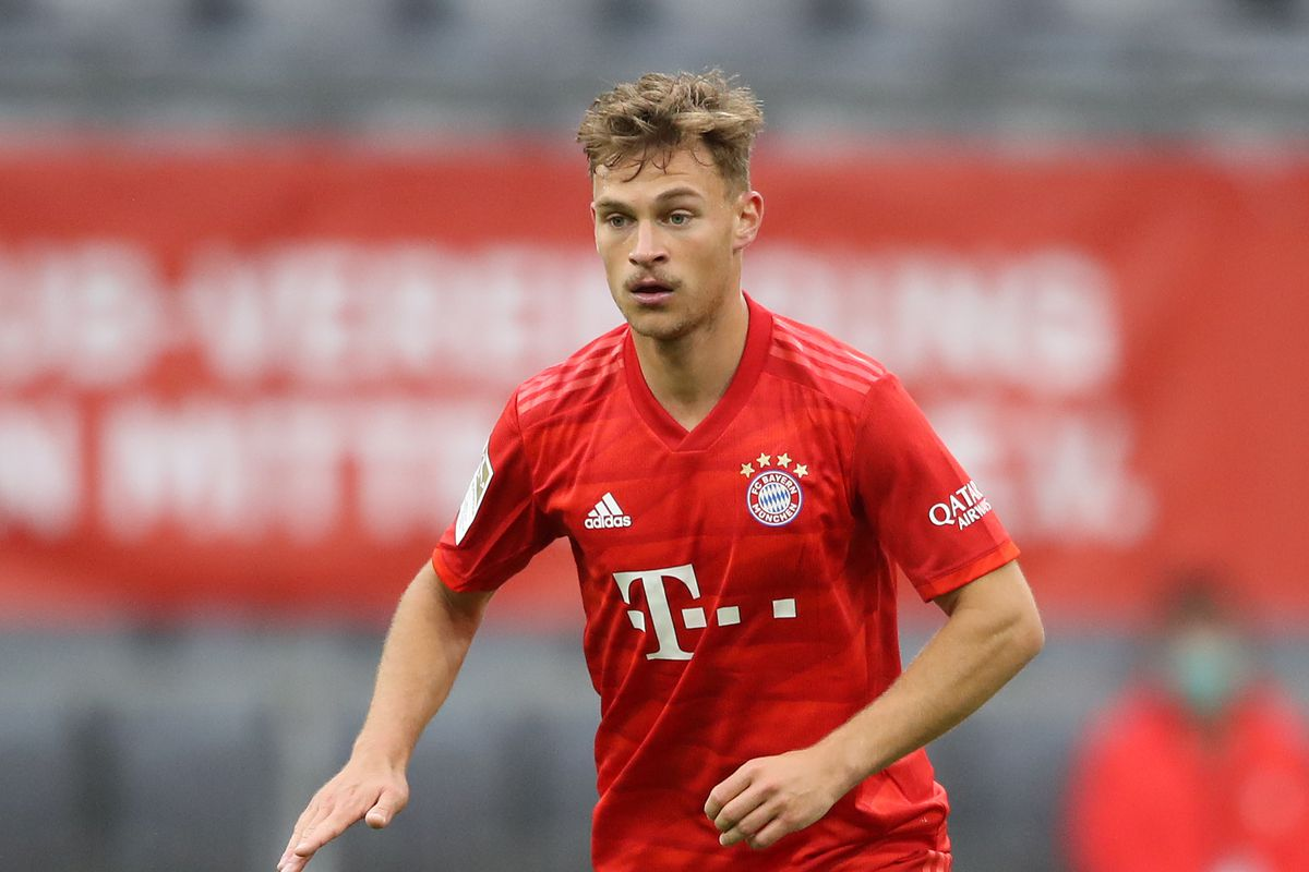 Joshua Kimmich of FC Bayern Muenchen runs with the ball during the Bundesliga match between FC Bayern Muenchen and Eintracht Frankfurt at Allianz Arena on May 23, 2020 in Munich, Germany.