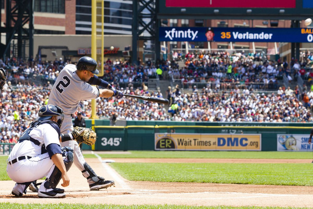 June 3, 2012; Detroit, MI, USA; New York Yankees shortstop Derek Jeter (2) hits a home run during the first inning against the Detroit Tigers at Comerica Park. Mandatory Credit: Rick Osentoski-US PRESSWIRE