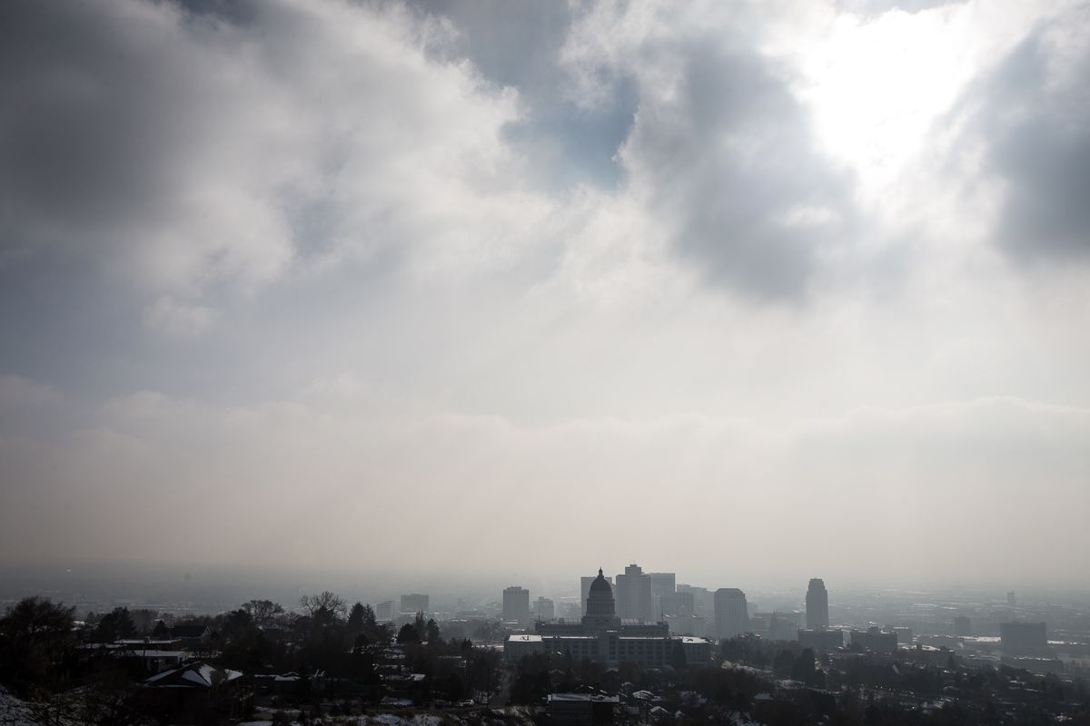 """FILE - Smog covers Salt Lake City as an inversion lingers on Sunday, Dec. 9, 2018. Researchers say a new University of Utah Health study has found """"upsetting"""" results showing women are at greater risk of losing their pregnancy within days of a spike in ni"""