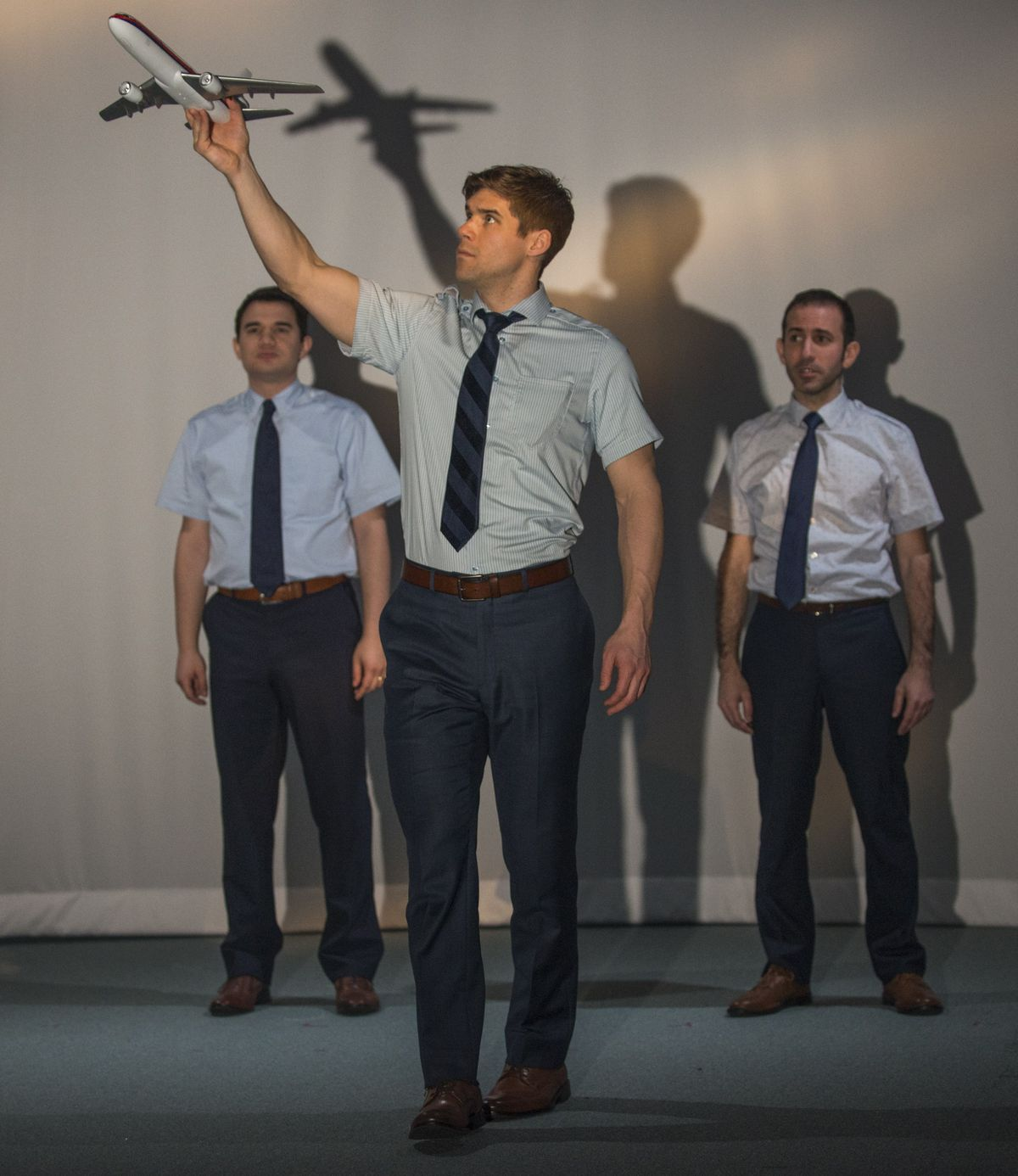 """The crew of """"United Flight 232"""" is portrayed by Rudy Galvan (from left), James Doherty and Johnny Arena. (Photo: Michael Brosilow)"""