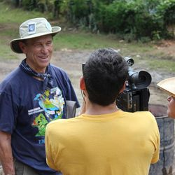 Two members of Storytellers for Good, which was started by Cara Jones, take a break from building a school to interview a volunteer with Project Grace while in Nicaragua. Project Grace helps people who have suffered the loss of a loved one heal through service and sharing.