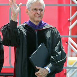 Supreme Court nominee Merrick Garland, a Niles West alumnus, waves onstage prior to speaking at Niles West's 2016 commencement ceremony Sunday in Skokie.   Tim Boyle/For the Sun-Times
