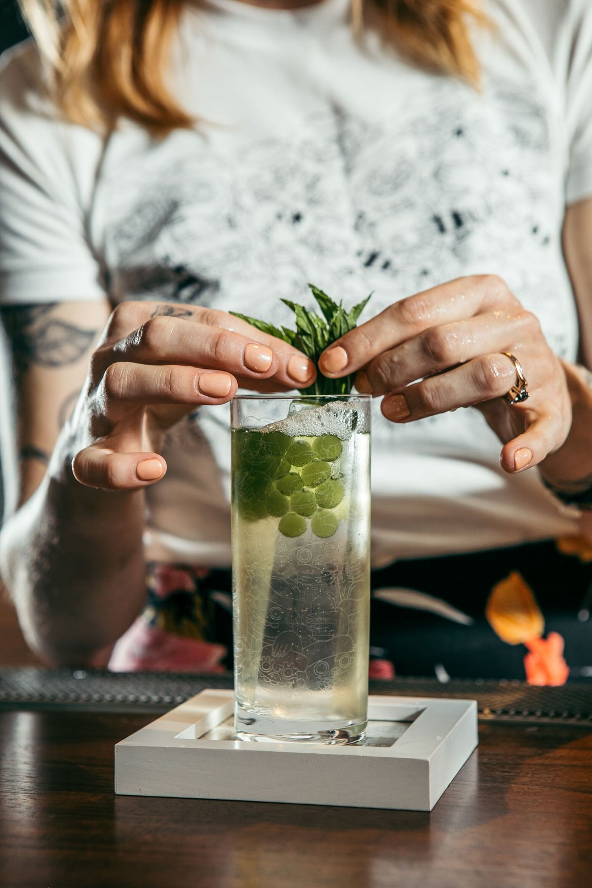 Katie Renshaw puts the final touches on Flex Yo Hustle, a cocktail she made during the United States Bartenders' Guild World Class.