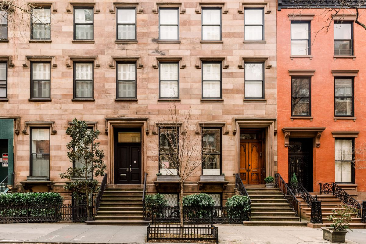 An exterior view of Brooklyn row houses in a story on Brooklyn rental rates dropping.