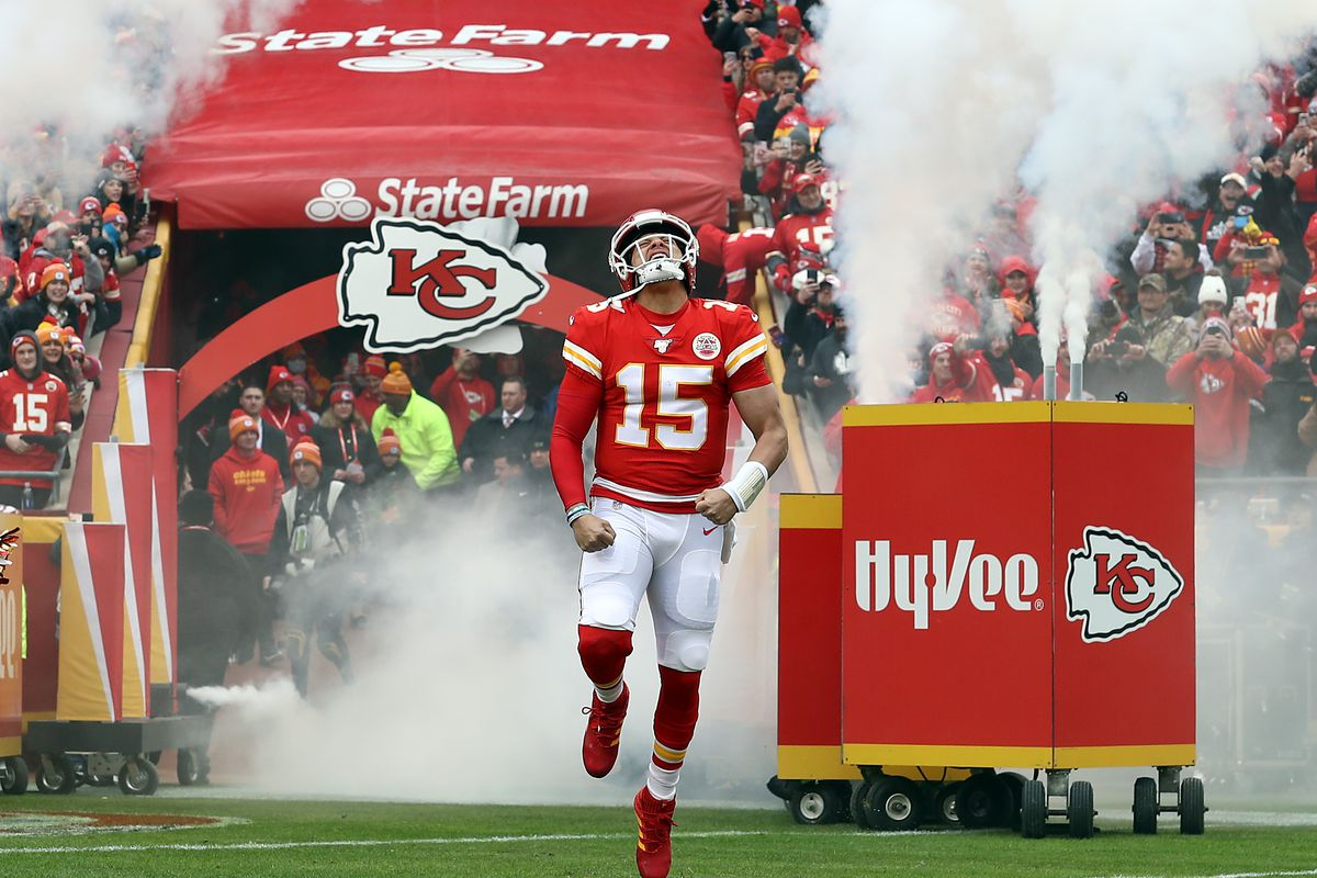 Quarterback Patrick Mahomes #15 of the Kansas City Chiefs runs out of the tunnel as he is introduced prior to the game against the Los Angeles Chargers at Arrowhead Stadium on December 29, 2019 in Kansas City, Missouri.