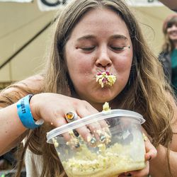 Emily Ward competes in the cole slaw eating contest during Chomp & Stomp.