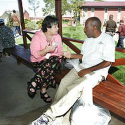 Rev. Linda Brewer, a volunteer chaplain at Camp Williams, talks to Jerome Kennedy, a refugee from New Orleans.