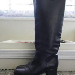 """Chanel boots, $1,300. """"These are so comfortable to walk around in."""""""