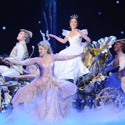 """Actress Laura Osnes, center, of Rodgers & Hammerstein's """"Cinderella"""" performs at the 67th Annual Tony Awards, on Sunday, June 9, 2013 in New York.  (Photo by Evan Agostini/Invision/AP)"""