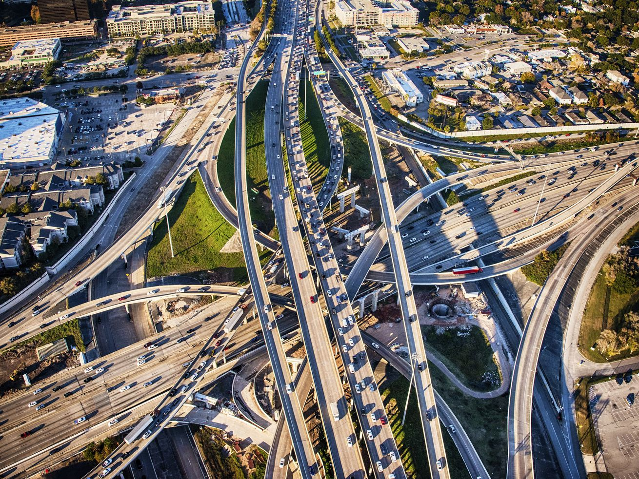 """These mayors pledged to reduce emissions. Why are they widening highways"""""""