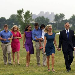 Republican Jon Huntsman Jr. walks with his wife, Mary Kaye, and other family members on his way to a press conference to announce his bid for the presidency at Liberty State Park June 21, 2011, in Jersey City, N.J.