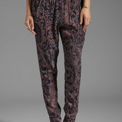 """""""These silky pants are California comfort mixed with downtown, New-York-City looks. Wrinkle-free silky rayon fabric holds its shape, and the slight slouchy silhouette suits all body types."""" Sam & Lavi, Junia pants, $160, and Manouche Boutique in Forest Pa"""