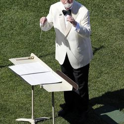 Composer John Williams conducts the Boston Pops during ceremonies celebrating the 100th anniversary of the first regular-season baseball game at Fenway Park before a game between the New York Yankees and the Boston Red Sox in Boston, Friday, April 20, 2012.