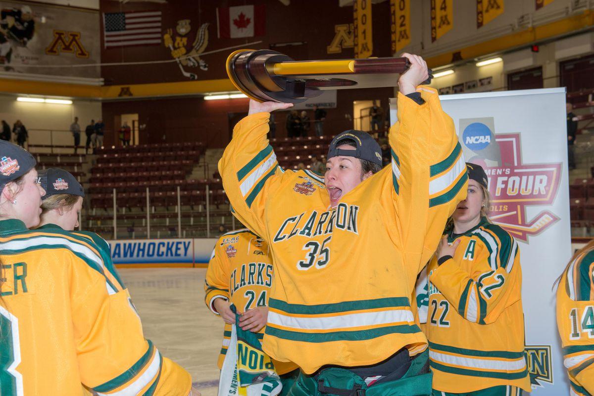 Shea Tiley raises the 2018 NCAA Women's Hockey Trophy