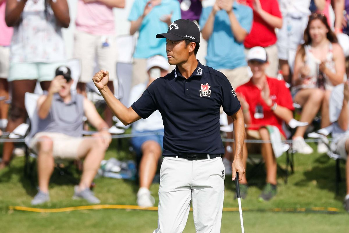 Kevin Na pumps his fist after making birdie on the 18th hole and winning the Charles Schwab Challenge golf tournament at Colonial Country Club.