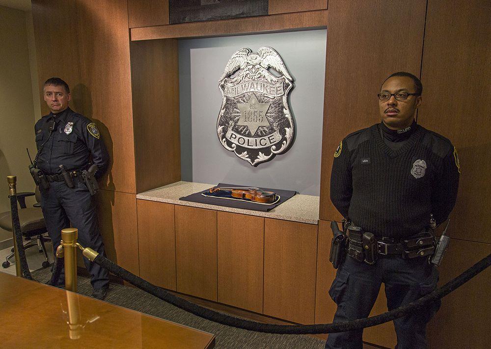 Milwaukee police with the violin.