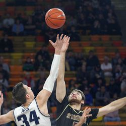 Aggie forward Justin Bean (34) battles St. Katherine's Zane Jowaiszas for the opening tip of Utah State's 94-49 win at the Spectrum on Dec. 10, 2019.