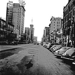 Cars line Main Street in 1949. The large First Security Bank sign towers over the street.