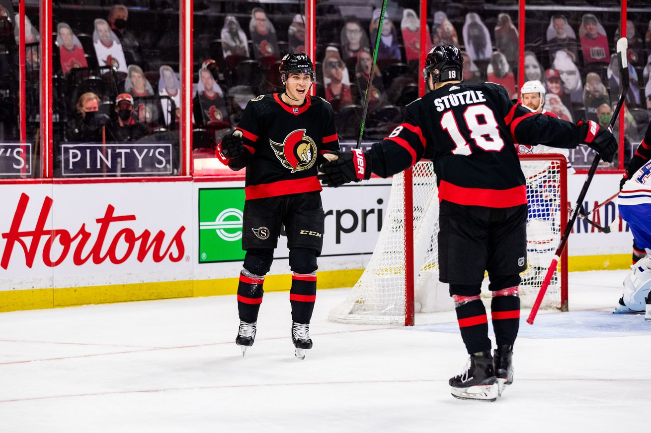 Ottawa Senators Center Shane Pinto (57) celebrates his first career NHL goal with Ottawa Senators Left Wing Tim Stutzle (18) during first period National Hockey League action between the Montreal Canadiens and Ottawa Senators on May 5, 2021, at Canadian Tire Centre in Ottawa, ON, Canada.
