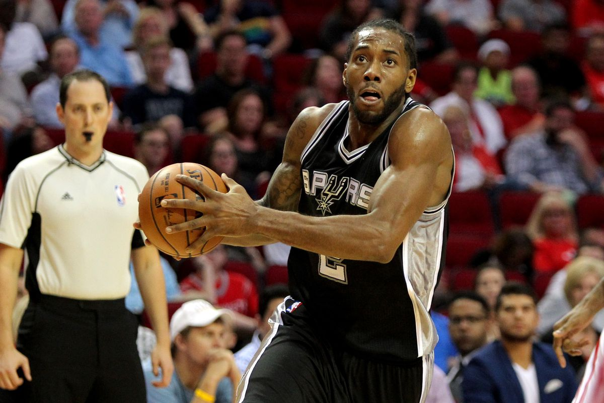 Kawhi Leonard drives past James Harden (not pictured) for a bucket