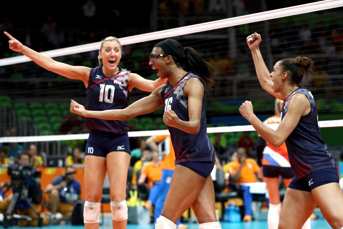 Jordan Larson-Burbach, Foluke Akinradewo and Alisha Glass of United States celebrate winning match point during the Women's Bronze Medal Match between Netherlands and the United States on Day 15 of the Rio 2016 Olympic Games at the Maracanazinho on August 20, 2016 in Rio de Janeiro, Brazil.