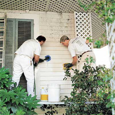 Men Cleaning House Panels