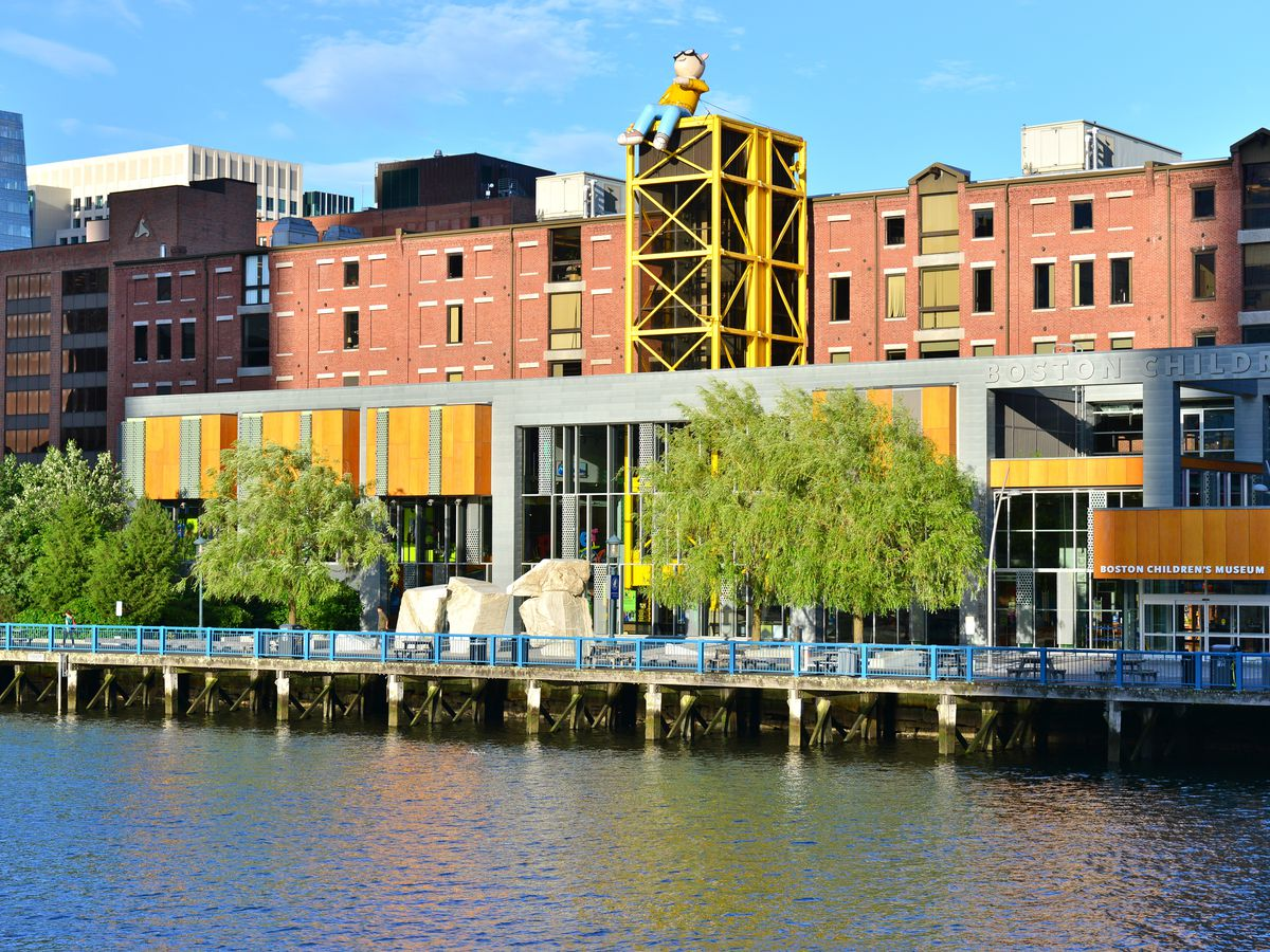 A waterfront with buildings including the Boston Children's Museum.