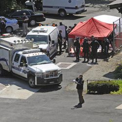 Police surround a temporarily built tent where the victims of the vehicle crash were brought, Sunday April 29, 2012, in New York. Authorities say an out-of-control van plunged off a roadway near the Bronx Zoo, killing seven people, including three children.